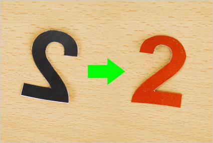 Le chiffre présente la surface rugueuse du papier de verre une fois retourné à l'endroit